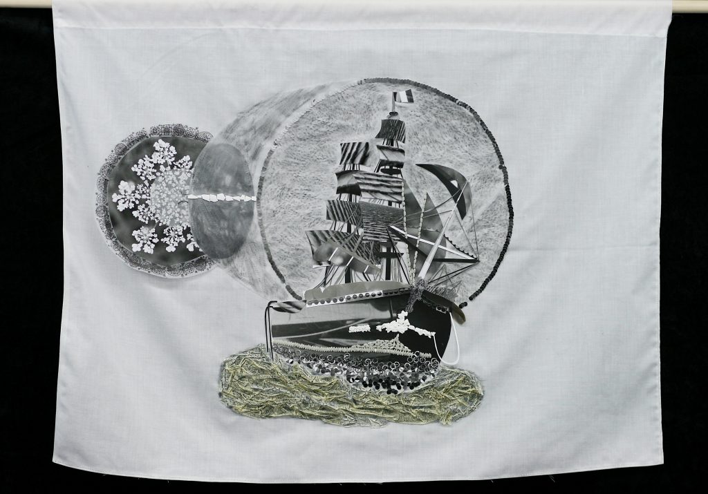 """A Ship and a Glass <br>2012 <br>black and white photography, egg shell, rice, feather, tracing paper, graphite, masking tape, charcoal, bed linen, wooden rod <br>22.5"""" x 29"""""""